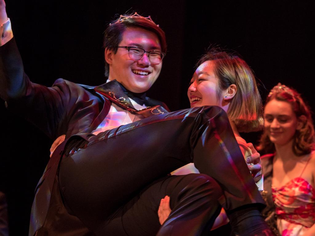 Senior Homecoming Court member Nolan Kim celebrates with fellow senior and close friend, Jazzy Cheng.